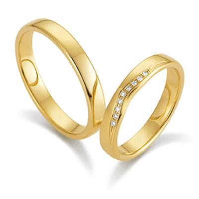 gerstner 28502 geelgouden smalle trouwringen met in de damesring briljant in een speelse vorm